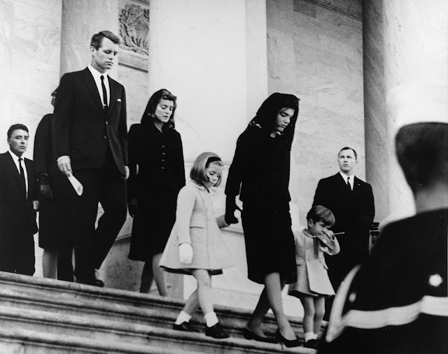 Kennedy family leaving the Capitol building after John F. Kennedy's funeral. Left to right: Peter Lawford, Patricia Kennedy Lawford (hidden), Robert F. Kennedy, Jean Kennedy Smith, Caroline Kennedy, Jacqueline Kennedy, and John F. Kennedy, Jr. (November 25, 1963) Photograph by Abbie Rowe