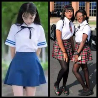 3 female Nigerian students dressed like in a Korean school