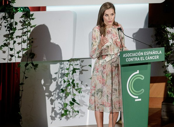 Queen Letizia wore Zara printed dress, Coolook Jewelry Sila earrings and carried Adolfo Dominguez clutch