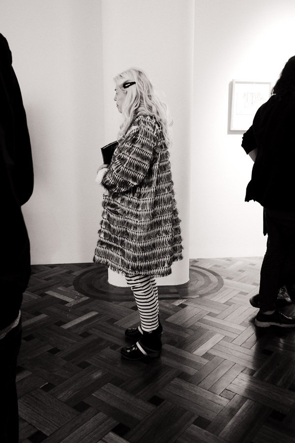 Striped tasselled coat and striped leggings. Photography by Kent Johnson for Street Fashion Sydney.