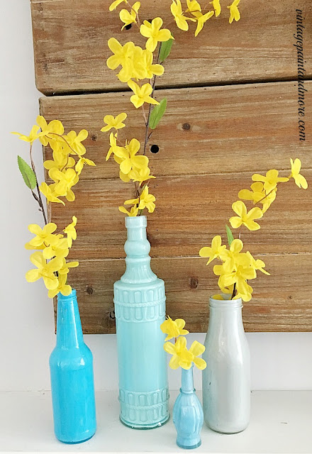 Vintage Paint and more... diy painted blue bottles with faux forsythia stems for a spring mantel