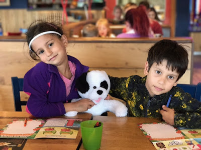 Children eating out with a teddy