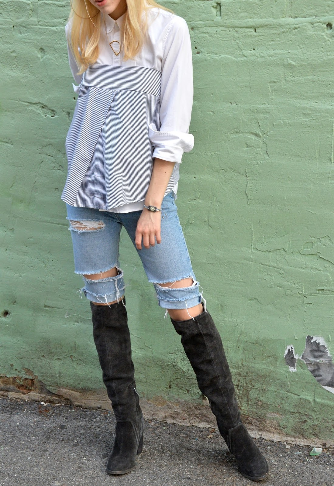Posing in a layered look wearing over the knee boots