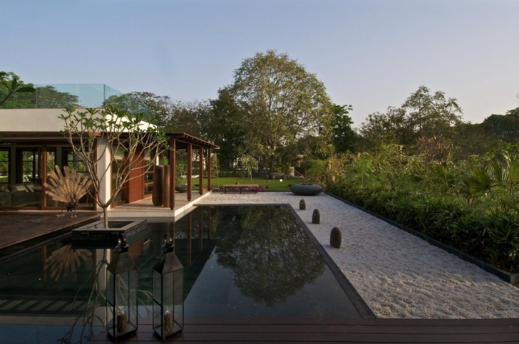 Pond in the backyard of Courtyard Home by Hiren Patel Architects