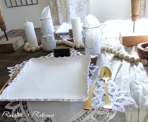 Summer table setting with white dishes