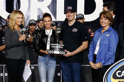 Team owner Kyle Busch and wife Samantha celebrate with the Champion Owner trophy in Victory Lane after Johnny Sauter (not pictured), won the #NASCAR CWTS Championship.