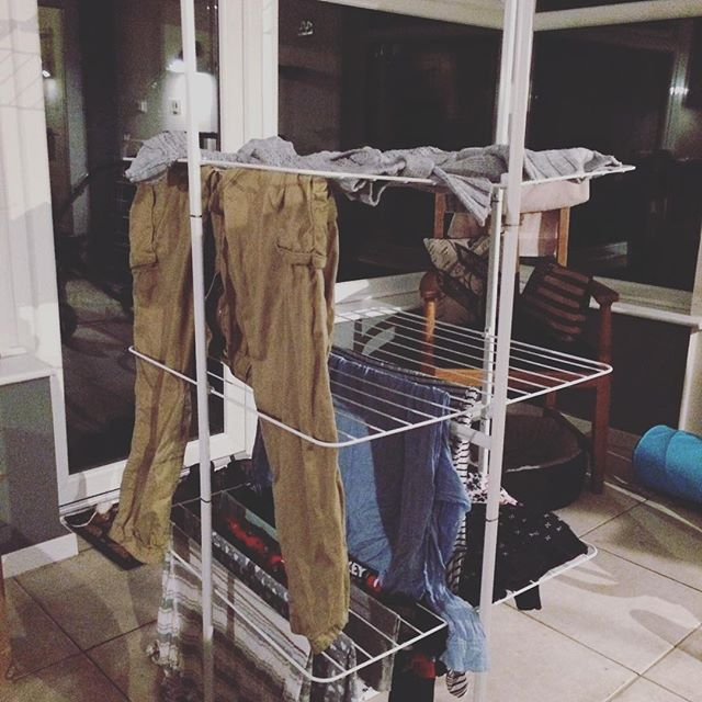 A large airer covered in clothes