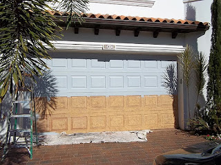 Painting a garage door to look like wood.