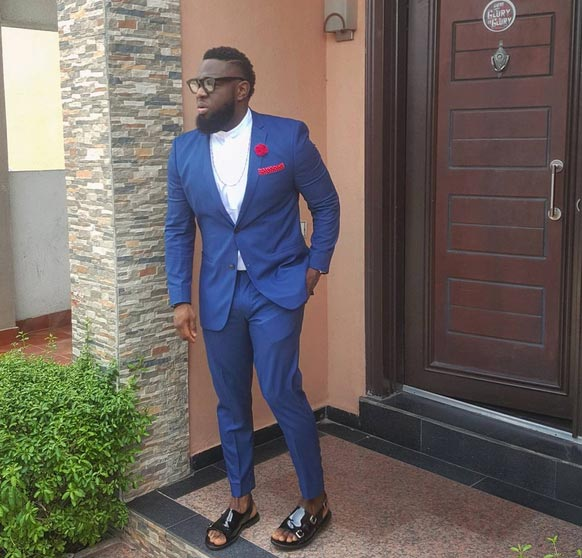 Rate this photo of Timaya rocking suit in sandals...