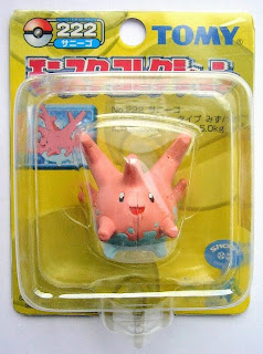 Corsola Pokemon figure Tomy Monster Collection yellow package series