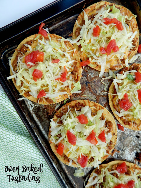 Oven Baked Tostadas...a simple, fun family meal!  Crunchy tostadas are layered with ground beef, refried beans and cheese and then topped with all the toppings! (sweetandsavoryfood.com)