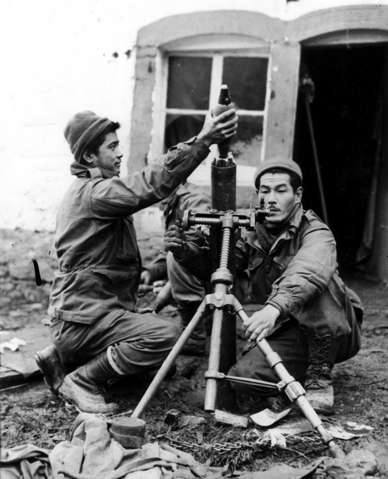 Soldiers fire mortar shells at German troops in France. Oct. 1, 1944.