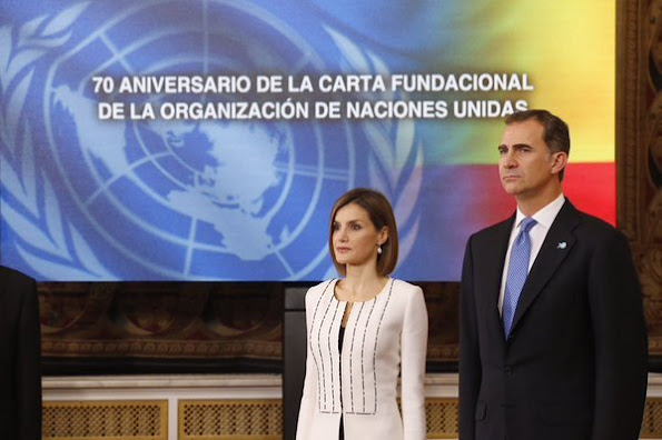 Secretary-General of the United Nations Ban Ki-moon, his wife Yoo Soon-taek Spain's King Felipe VI and Spain's Queen Letizia listen to the Spanish national anthem at the Royal Palace