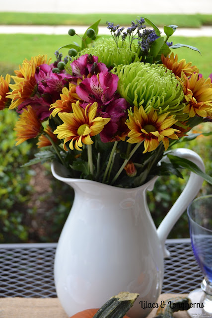 fresh fall flowers in a white pitcher