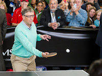 Microsoft co-founder Bill Gates plays table tennis against prodigy Ariel Hsing, unseen, along with Berkshire Hathaway Chairman and CEO Warren Buffett, unseen, outside the Borsheims jewelry store, a Berkshire Hathaway subsidiary, in Omaha, Neb., Sunday, May 1, 2016. (Credit: AP Photo/John Peterson) Click to Enlarge.