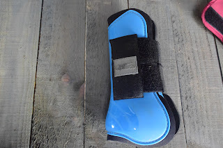 One light blue tendon boot for horses