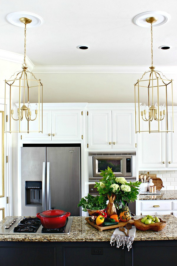 gold lantern pendants, white kitchen cabinets, fall decor