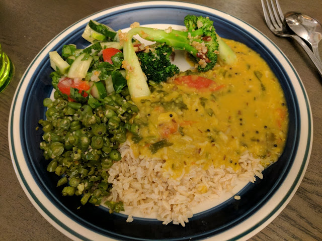 cucumber and tomato salad, garlic sesame broccoli, red lentil daal on brown basmati rice, green beans curry