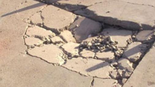 Cracked concrete pavement required repair
