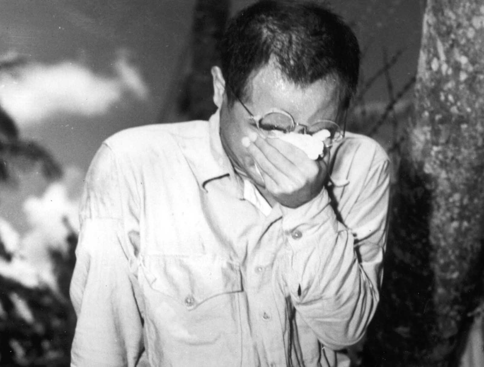 A Japanese prisoner of war at Guam, Mariana Islands, covers his face as he hears Japanese Emperor Hirohito making the announcement of Japan's unconditional surrender on August 15, 1945. World War II had come to an end.
