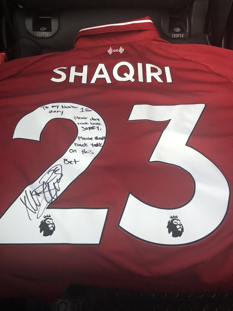 Xherdan Shaqiri gives Jamie Carragher a signed shirt with a special message for Gary Neville written on the back