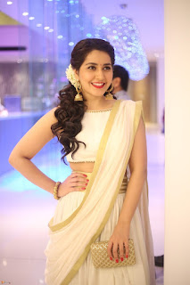 Raashi Khanna in designer Saree Deep Neck Gowns at opening of a Store Launch wow