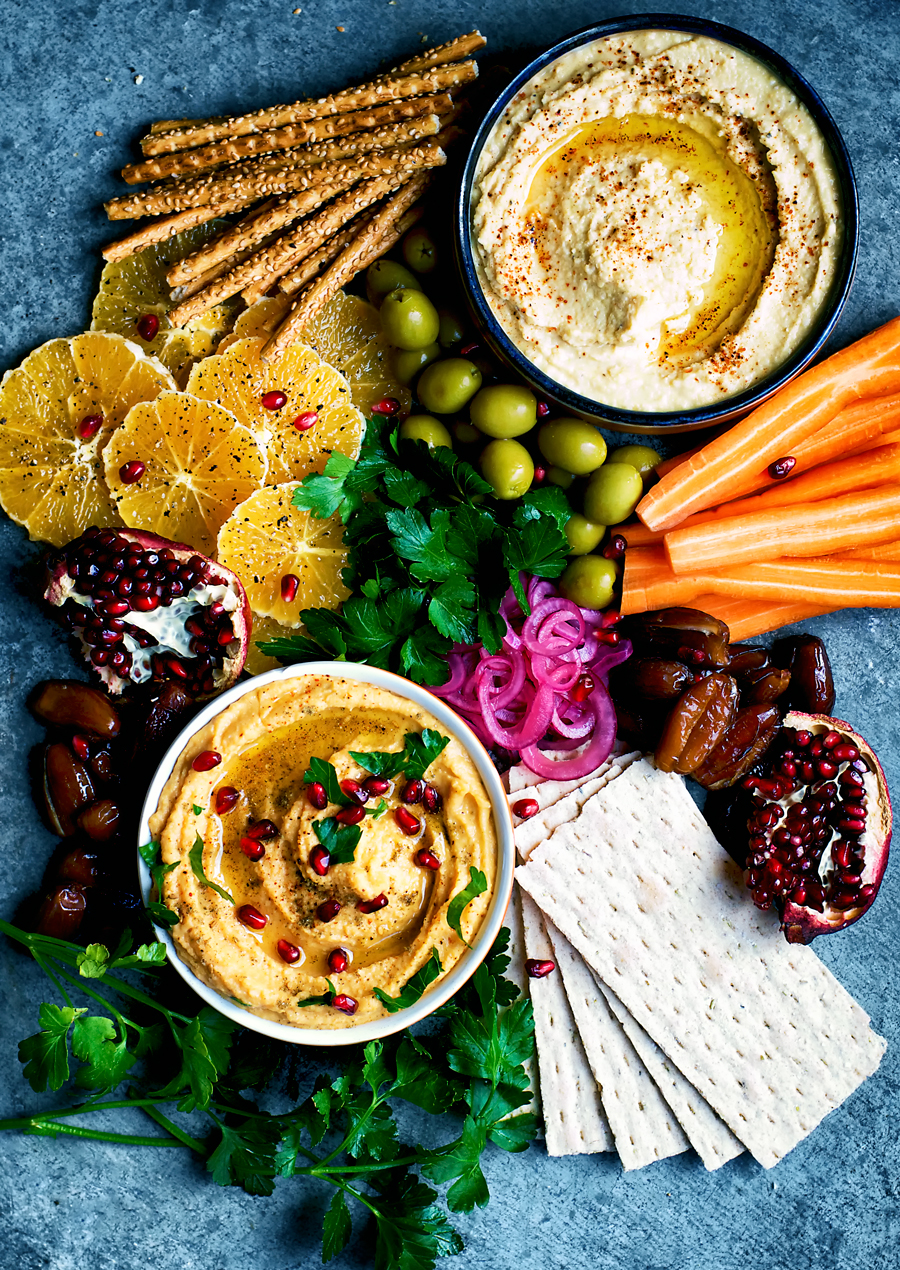 Vegan sweet potato lentil hummus with roasted sweet potato and garlic for a mellow, sweet flavour. The best hummus I've ever tried and perfect with a mezze of winter vegetables.