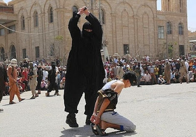Public beheading of a young man by IS extremist (file photo)