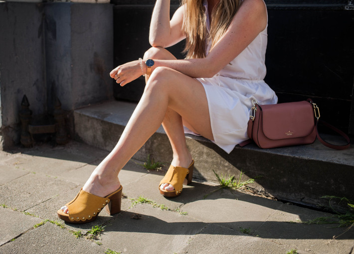 white shirtdress, yellow clogs, pink kate spade bag