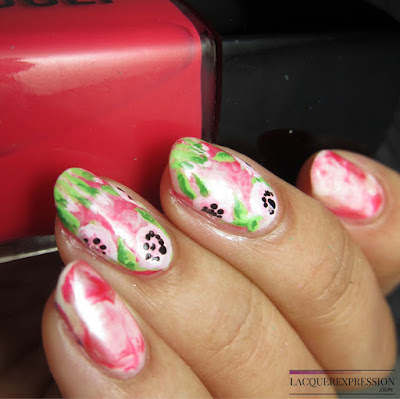 hand painted floral nail design art over a pink smooched manicure