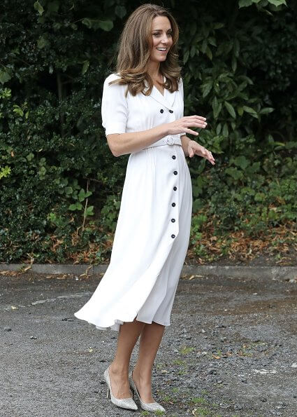 Kate Middleton wore Suzannah flippy wiggle dress and Boden Viola maxi shirt dress. Tabitha Simmons silver pumps. Adidas shoe