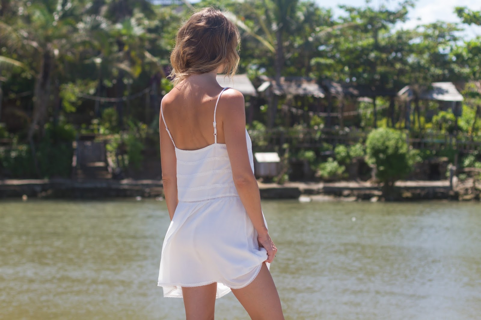Fashion blogger and designer, Alison Hutchinson, is wearing a KAYVALYA Maya Dress in white