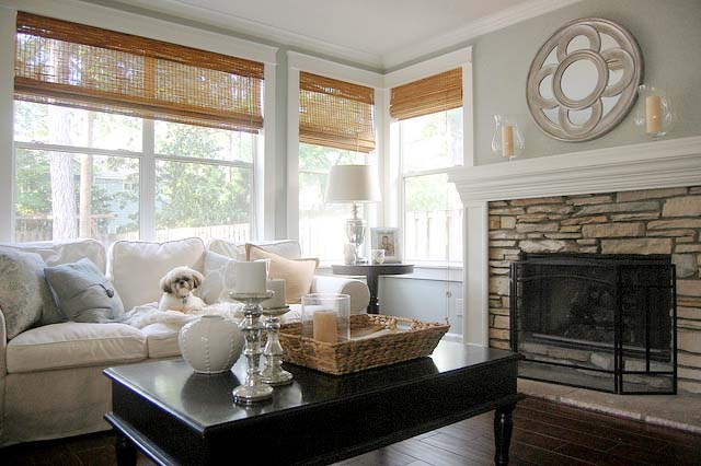 brick fireplace and roman shades