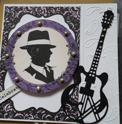 Man with trilby hat in silhouette with guitar - Celebrate!