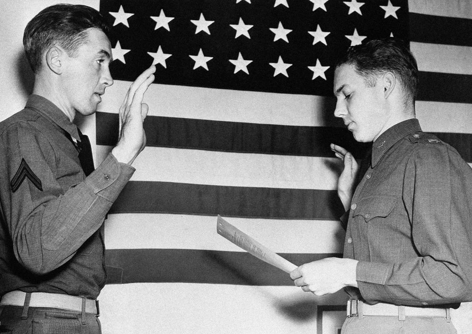 Jimmy Stewart, former movie star, is sworn in as a second lieutenant in the U.S. Air Corps by Lt. E.L. Reid, personnel officer of the west coast training center at Moffett Field, California, on January 1, 1941. Stewart was one of Hollywood's most popular actors before he was inducted into the Army in 1941.