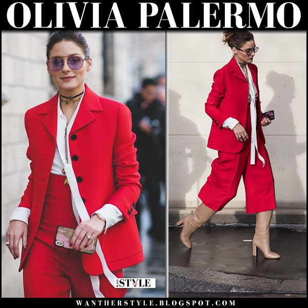 Olivia Palermo in red jacket, red trousers and tan leather boots prada and westward leaning sunglasses fashion week style january 22