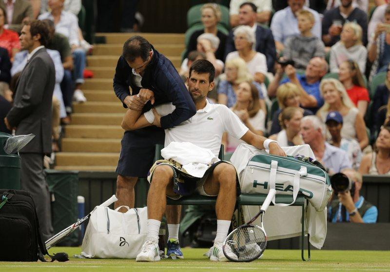 Novak Djokovic reaches Wimbledon quarters with injured shoulder