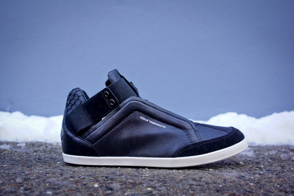 6dc44f3d6 Yohji Yamamoto and adidas continue their collaborative line into 2014 with  the Kazuhiri. The low-mid hybrid silhouette features a blacked out upper in  a mix ...