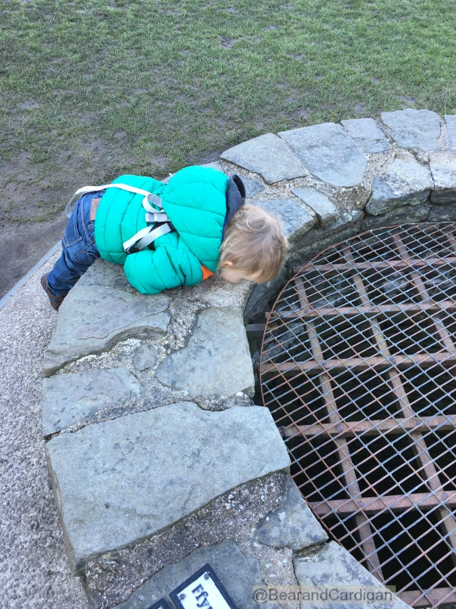 Caerphilly-Castle-with-toddler-looking-down-well