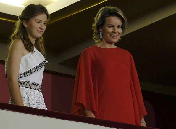 Queen Mathilde wearing a new red dress at a final of the Queen Elisabeth Music Competition. Crown Princess Elisabeth wore a white shoulder open embroidered dress