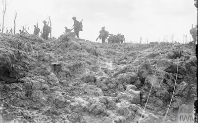 Battle of Langemarck. British troops moving forward over shell-torn ground near Pilckem, 16th August 1917. © IWM (Q 2708). IWM Non-Commercial Licence