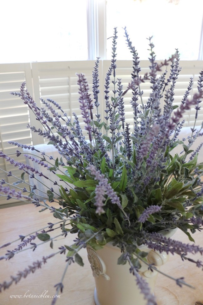 Faux lavender stems with green leaves at the base look realistic