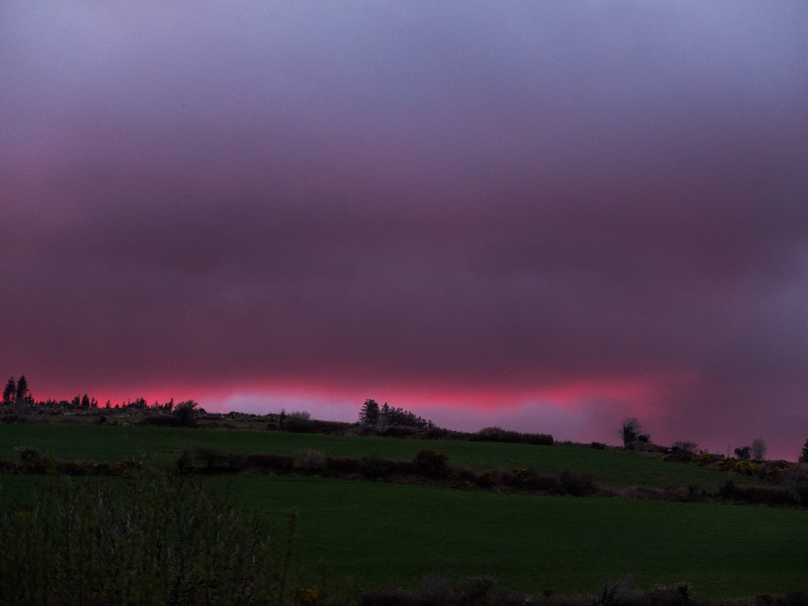 Pink ribbon in a cloud after a sundown over a mountain side in Co.Cork, Ireland.
