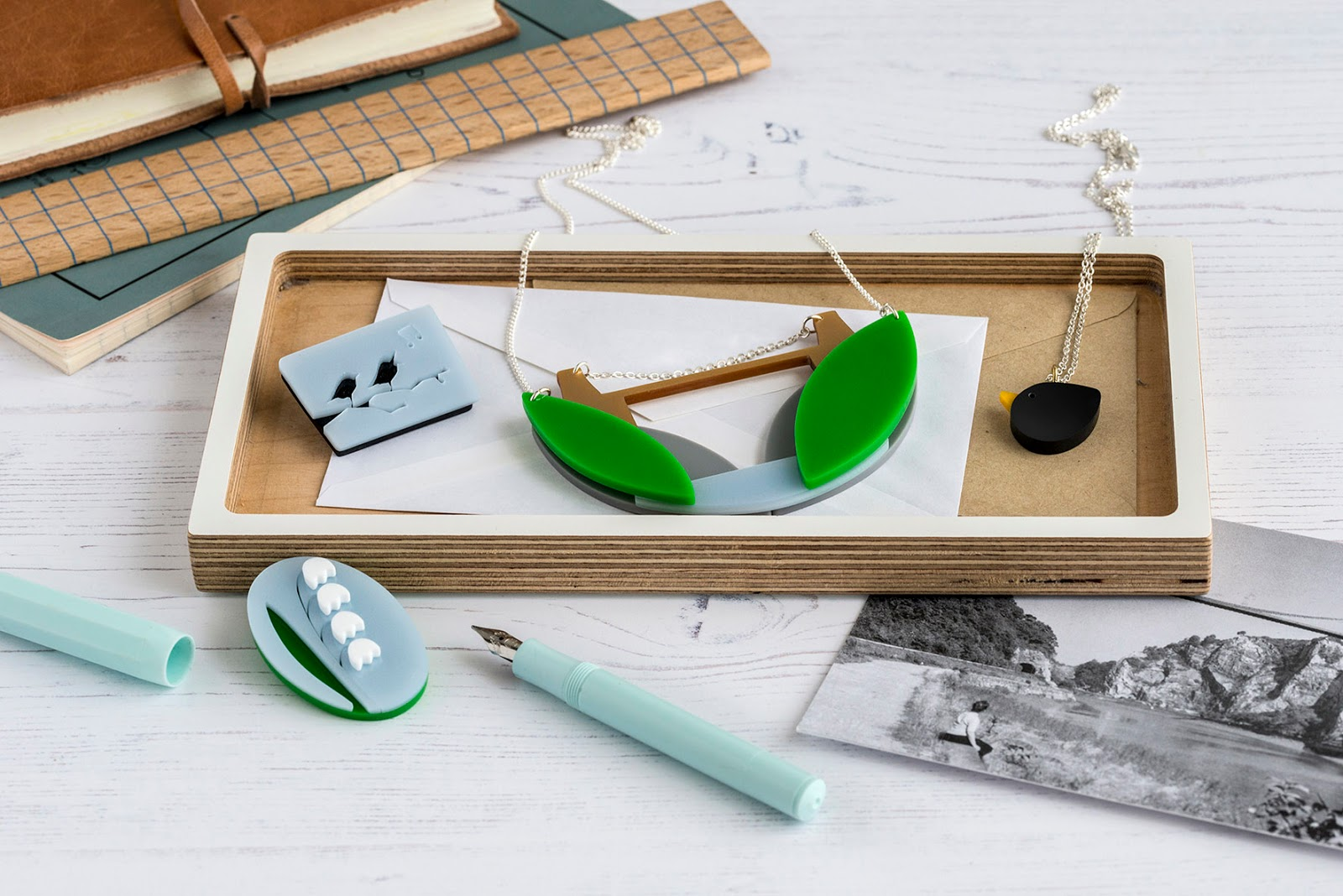 One of the most popular range of jewellery by I Am Acrylic includes their Lily of the Valley brooch, as well as the Clifton Suspension Bridge necklace and blackbird necklace.