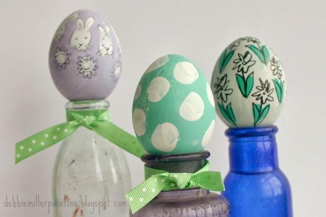 pastel and black sharpie marker easter eggs on glass bottles