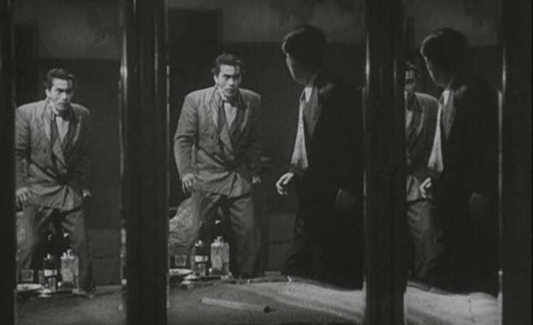 Matsunaga (Toshiro Mifune) battles Okada in front of mirrors in Kurosawa's Drunken Angel.