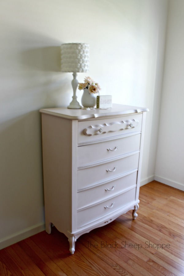 Chest of drawers painted in pink.