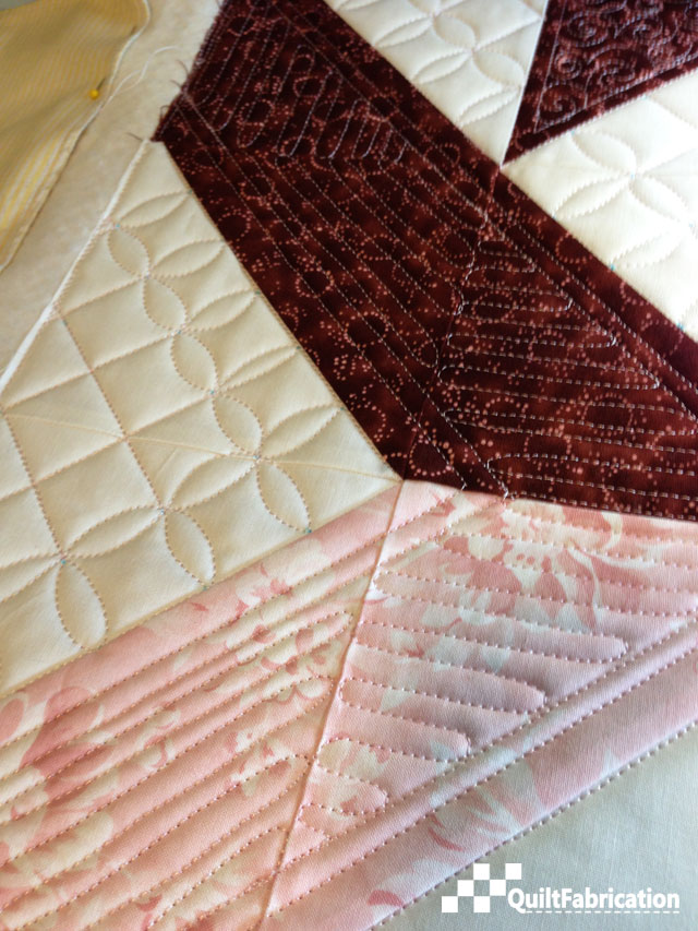 Closeup of the quilting in the print bands of Jess