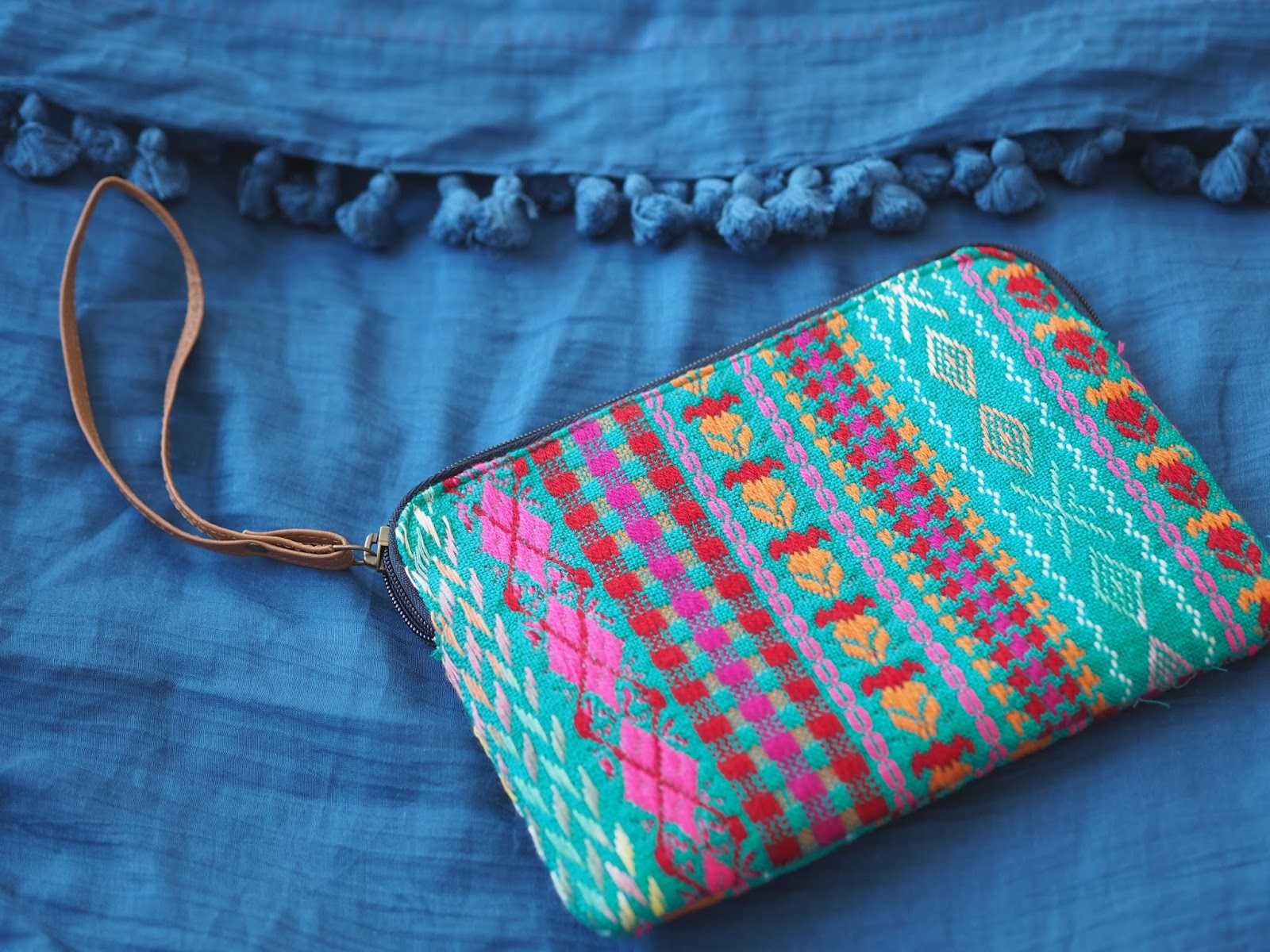 Blue pompom scarf and Aztec pouch