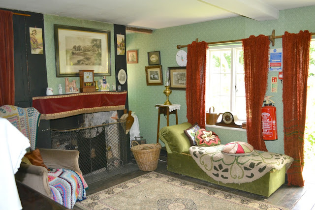 The sitting room of Wartime Cottage with old furniture